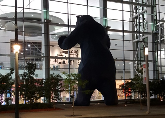 Picture of a 40' Blue Bear Sculpture looking into a convention center.