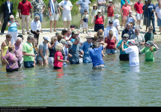 people wading into water.png
